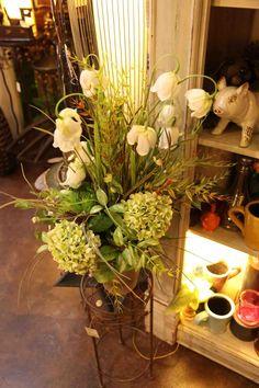 beautiful silk floral arrangement in greens creams with hydrangeas tulips botanical