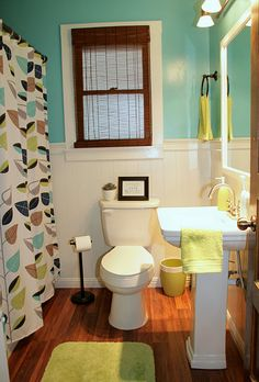 Bathroom Paint Color: Surfer by Behr. And I already have that shower curtain! Woo.