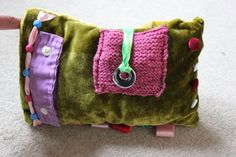 Mrs Yopey has made her first fiddle cushion - Mr Yopey no longer has a wearable purple shirt!