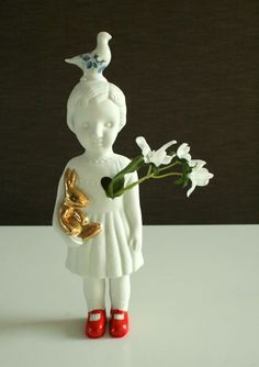 One flower vase Clonette doll by Lammers en Lammers, two Dutch sisters who make traditional Dutch figures in porcelain.
