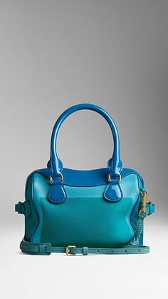 Burberry Bright turquoise/bluebell The Mini Bee in Hand-Painted Leather with Patent Trim - A hand-painted leather mini bag with a vivid border artwork and high-gloss patent trims. The bag features a double-layered construction with concealed wing pockets for easy access, while the grosgrain interior has two pockets and leather-bound seams. Discover the women's bags collection at Burberry.com