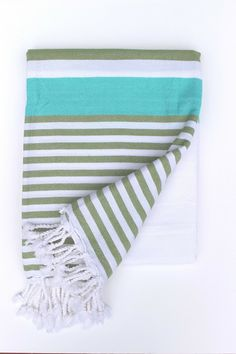 Ottoloom Bondi in Olive Aqua. Hand loomed with GOTS certified organic Turkish cotton.