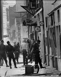 Police officers in front of Black Panther office, 4115 Central Avenue, after raid. December 8, 1969, Los Angeles, California, 1969