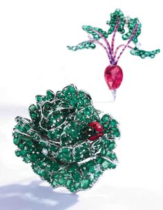 GROUP OF WHITE GOLD AND GEM-SET JEWELRY – The ring centering a green enamel ladybug & flanked by round diamonds, accented by round sapphires, size 5½, signed Aaron Basha (not shown). The first brooch designed as a head of lettuce set with round emeralds weighing approximately 10.00 carats, accented by round diamonds, further decorated with an enamel ladybug and worm.