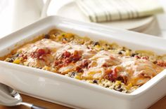 Santa Fe Chicken Casserole   *chicken, salsa, rice, cream of chicken soup, black beans, yellow peppers, cilantro, four cheese blend - YUM!