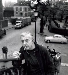 by Robert Doisneau, Prévert au Pont de Crimée, 1955