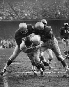A Lion goes down after making a touchdown during a game verses Chicago in 1958.  (The Detroit News)