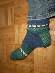 These socks were entered in Simply Socks Yarn Company's Summer of Color Contest 2010, and Amy shared her pattern. It's available on the store's blog.