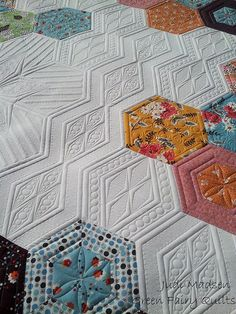 Hexagon quilt quilted by Judi Madsen