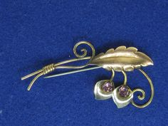 Vintage Sterling Silver Gold Plated Leaf and Gem Flowers Brooch Pin by HipTrends2015 on Etsy https://www.etsy.com/listing/288859371/vintage-sterling-silver-gold-plated-leaf
