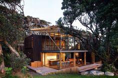 Under Pohutukawa Beach House by Herbst Architects - Piha North, New Zealand - Photos: Patrick Reynolds