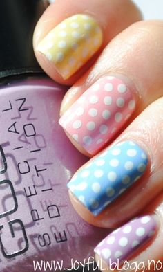 Different colored nails and polka dots