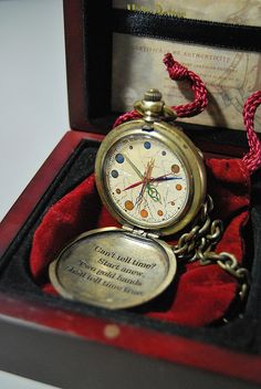 """Dumbledore's pocket watch  """"It was a very odd watch. It had twelve hands but no numbers; instead, little planets were moving around the edge.""""   not exactly how it's described in the book- but close enough Harry Potter"""