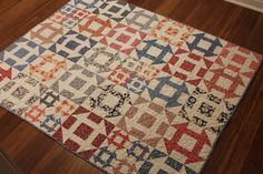 """This churn dash quilt is so charming! Made from 1930's reproduction fabrics in red and blue makes for a quilt with a very old fashioned feel.  The mini blocks scattered throughout the quilt adds a bit of modern flair and interest to the quilt.  This quilt measures 52"""" x 62.5"""" - perfect for a lap quilt or to use at the foot of the bed for those cooler nights when you need a little extra warmth. It would be cute in a child's bedroom or thrown over the back of a sofa or rocking chair."""