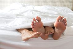 Google Image Result for http://cdn.sheknows.com/articles/2011/01/Couples_feet_in_bed.jpg
