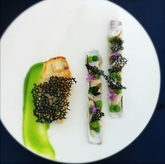 """Thierry Marx Looks like razor clams w/ pea puree but not sure what the cool black """"web"""" is."""