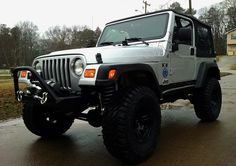 My 2006 Jeep TJ with 3.5 Rubicon Express Superflex lift, Pro Comp 33 x 12.5 tires, Poison Spyder bumpers front and rear, Poison Spyder Rocker Knockers, Warn M8000-S winch, Micky Thompson 15 inch Sidebiter wheels