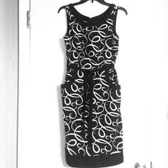 Figure flattering black and white sleeveless dress This classy dress is figure flattering on any body type. The top is fitted and comes in at the waist with a black tie belt. The bottom portion has a bit more room and features pockets on the front. Hemline comes just above the knee. Make an offer or added to a bundle for 20% off. Dresses