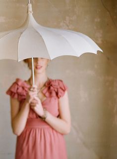 I used to have a pink umbrella like this.  It had a ruffle around the edge.  Loved it.  My MIL bought it for me when my husband and I were first married.