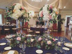 King table design full of fresh garden roses ,ivory hydrangea ,cabbage roses ,navy blue privet berry, café au leit dahlias,silver dollar eucalyptus . www.KarrieHlistaDesigns