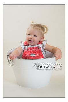 Baby girl, overalls, bucket, baby photographer, one year old photos, www.endlessimagesphotography.com