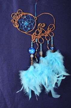 "Dreamcatcher size of a large ring 14х10 cm in total length - 29cm, Handmade lampwork, crystal, feathers,  ceramics, crystals  If you need really works amulet subject of strength, not a symbolic souvenir - buy Dreamcatcher Chinese shop where fishers near neighbor goods ""all on 1$."" - Would be a waste of money. Unfortunately, Catchers many perceived as a piece of furniture and cheap souvenirs.  History of the origin of the amulet narrate quite superficial fact Dreamcatcher as a protective…"