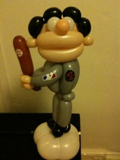Could our local balloon designer create a large baseball player like this?