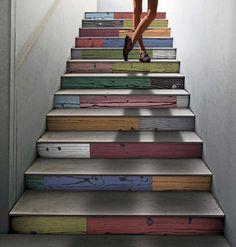 Modern porcelain floor tile used on stair risers. Like it.