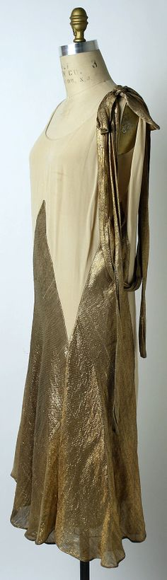 Evening dress House of Lanvin  (French, founded 1889)   Designer: Jeanne Lanvin (French, 1867–1946) Date: spring/summer 1927 Culture: French Medium: silk, metallic thread. Sideway