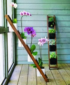 11 Spring Decorations for the Apartment - Check out the unique presentation with this ladder.  Perfect for tight spaces.