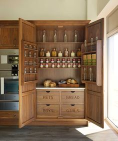 Snug Kitchens Newbury Bespoke Edwardian Range.  This shot shows a modern interpretation of a traditional larder in bleached walnut with a cold slab in natural quartzite stone to match the worktop and splashback.