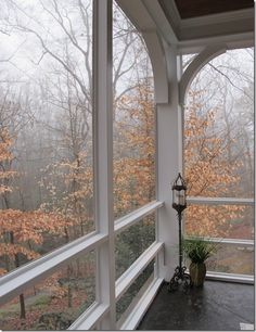 Screened Porch...style for back den area screen porch? Love the circular architect in the upper corners...*sigh*