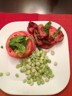 Friday, 9/28/12 Tomato, Bacon and Avocado stacks, lima beans. This is loosely based on a Cooking Light recipe. Layers of tomato, bacon, basil and avocado, drizzled with bleu cheese dressing. Great way to get the last few summer tomatoes in a dinner.