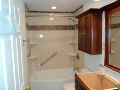 New tub, tile, vanity and cabinet