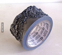 Artist carves topographical map into electric tape.