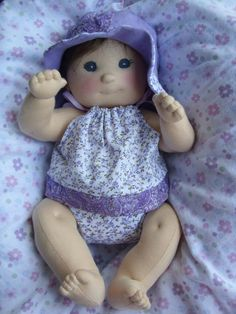 I want to have a go at making a doll. This doll is gorgeous!!!