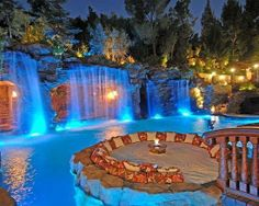 Gorgeous. Fire pit area near water.....cave dining area? place for wine cellar leading into house?