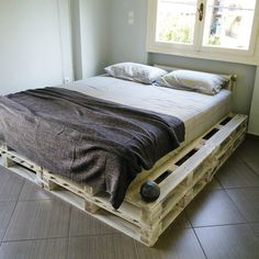 chic white painted stacked pallet platform bed