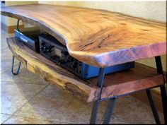 This log TV stand was made from solid Avocado wood and has raw steel legs. Live Edge Furniture, Log Furniture, Furniture Making, Modern Furniture, Furniture Design, Furniture Outlet, Wood Slab Table, Wooden Tables, Live Edge Wood