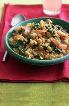 Indian-Spiced Lentils with Spinach and Rhubarb. Looking for something to do with your rhubarb?  Try Indian food in place of that default crumble cake recipe.