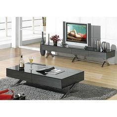 """Details Beautiful modern coffee table with durable oak veneer. Goes well with any kind of decor. Features and Benefits Dark oak finish, nearly black Material: Durable dark oak veneer Line around the coffee table color: Silver Top Material: Glass Base Material: Manufactured wood Weights & Dimensions Overall: 13.5"""" H x 27.5"""" W x 47.25"""" D Overall Product Weight: 154 lbs SHIPPING TIME: EXPRESS Express ( 4-7 Days)Standard (1-2 Weeks)Medium (2-3 W..."""