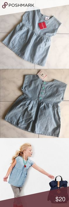 Hanna Anderson Chambray Button Top Adorable Hanna Anderson Girl's chambray top. Pockets. Button back detail. 100% cotton. NWT!! Size 110 (4-6 years) Hanna Andersson Shirts & Tops Blouses