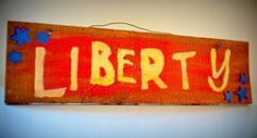 $8.00 This ready-to-hang wooden liberty sign is a great patriotic addition to your home decor, both indoor and outdoor. It is made from recycled wood and created by a skilled woodworker. It is hand-painted with child-font lettering.  Length is about 18.5 inches, Width is about 3/4 inches and Height is about 5 inches
