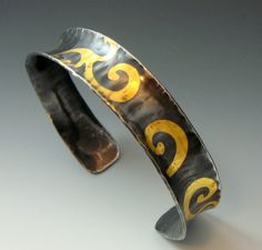 beautiful keum boo design and oxidization, and nice anticlastic cuff