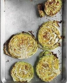 Preheat oven to 400 degrees. Brush a rimmed baking sheet with 1 tablespoon extra-virgin olive oil. Place 1 medium head green cabbage, cut into 1-inch-thick rounds, in a single layer on sheet and brush with 2 tablespoons oil. Season with coarse salt and ground pepper and sprinkle with 1 teaspoon caraway or fennel seeds. Roast until cabbage is tender and edges are golden, 40 to 45 minutes.