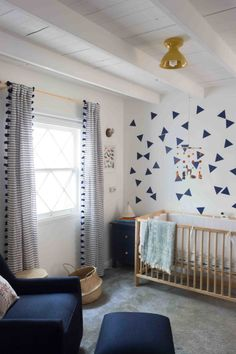 Modern Nature Inspired Nursery. Loving the triangle wall decals that give this room that subtle modern edge!