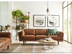 Again the white with the mid century modern furniture is just beautiful. I love the leather working with wood and metal and the rough rug. And although the table is a little small, the sightline across the back wall is very nicely proportioned.