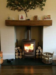 Charnwood C-Four in bronze, honed granite hearth, medium character medium colour oak fireplace beam. Fireplace Beam, Log Burner Fireplace, Wood Burner, Living Room With Fireplace, Fireplace Design, Electric Stove Fireplace, Log Burner Living Room, Fireplace Poker, Home Interiors