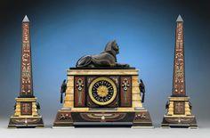 Egyptian Revival Clock Garniture, Circa 1885. M.S. Rau Antiques, New Orleans.