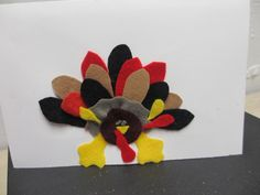 TURKEY....turkey....various multi colored hand cut felt to make up this one of a kind card art